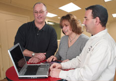 a couple and salesman using Basement Vision software