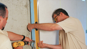 installing a basement wall finishing system in
